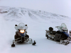 Snowmobiles parked on the glacier