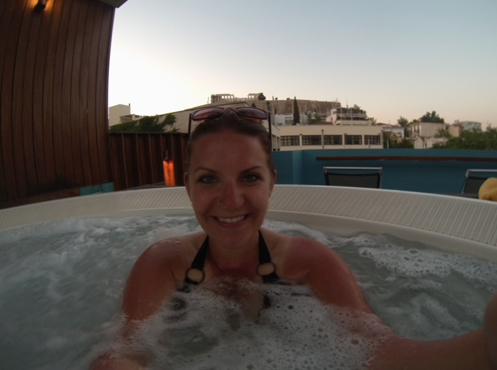 Showing off my awesome sunburn in the hot tub. Oh, and that's just the Parthenon in the background, no big deal.