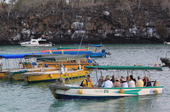 Tourists in a water taxi in Puerto Ayora